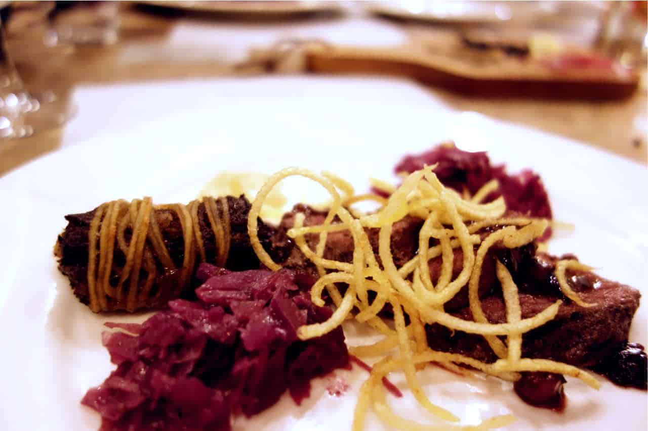 Strips of kangaroo meat, served with crispy potato noodles, red cabbage slaw and Illawara Plum jus.